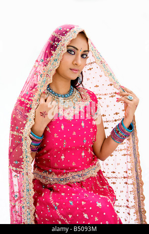 Beautiful Bangali bride in colorful dress and veil isolated - Stock Photo