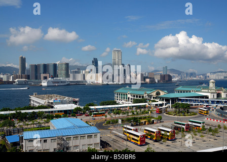 View towards Kowloon and Hong Kong Harbour from Hong Kong Island with Star Ferry and bus terminals - Stock Photo