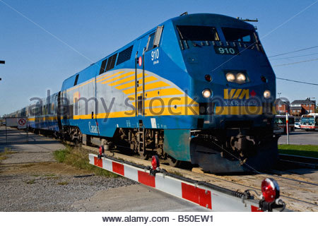 Fast moving Via Rail Montreal and Toronto express train in the Port Union area of Toronto Ontario Canada - Stock Photo