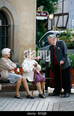 Sep 2008 - Elderly people in Ribeauville village Alsace France - Stock Photo