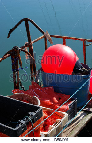 Tackle stored in crates on the back of a fishing boat, Weymouth, Dorset, England, UK - Stock Photo