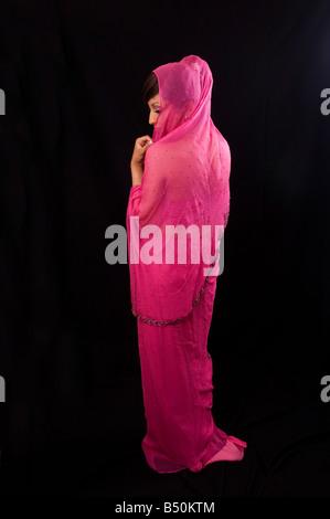 Indian woman in red sari - Stock Photo