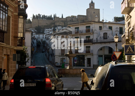 Spain. Center of Antequera early in the morning. Fortifications and church above. - Stock Photo