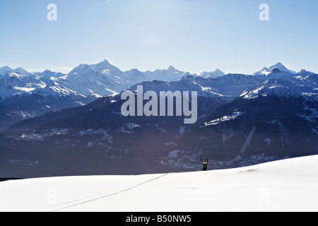 Person downhill skiing Alps Switzerland - Stock Photo