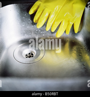 Close up of washing up gloves on the kitchen sink