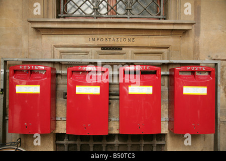 Row of four postboxes outside the main post office in Florence, Italy. - Stock Photo