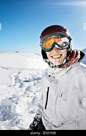 Close up of a young man smiling in ski wearan Alps Switzerland - Stock Photo