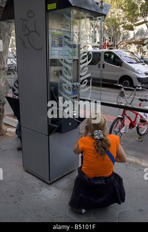 Woman on phone Telefonica telephone kiosk barcelona spain - Stock Photo