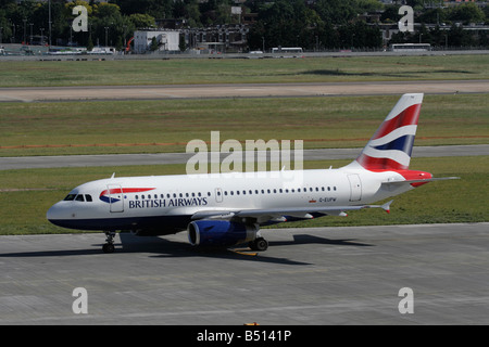 British Airways Airbus A319 passenger jet plane taxiing on the ground at Heathrow Airport - Stock Photo