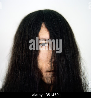 Close up of a young man s face covered with hair - Stock Photo