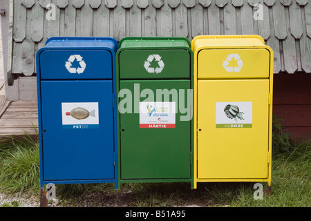 Romania Europe Three colour coded blue green yellow recycling bins for plastic paper and metal - Stock Photo