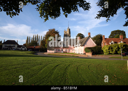 Cavendish in Suffolk showing traditional pink thatched cottages and village green - Stock Photo