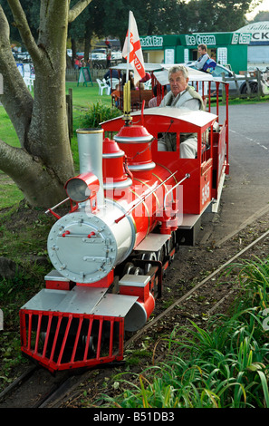 Model miniature train ride in Clevedon park North Somerset England - Stock Photo