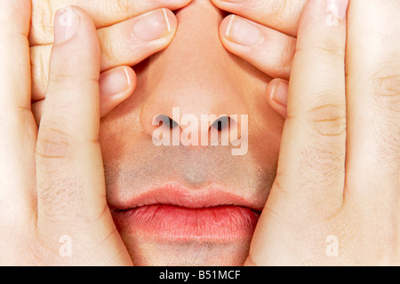 Hands Covering Man's Face - Stock Photo