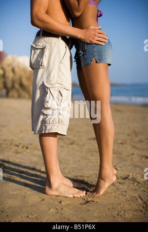 Couple Kissing on the Beach, Corona del Mar, Newport Beach, California, USA - Stock Photo
