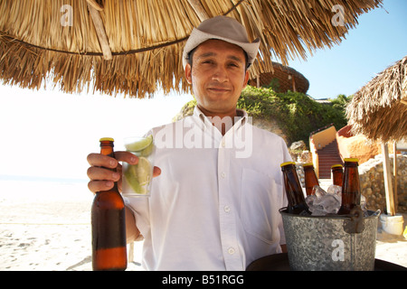 Portrait of Waiter at Beach, Mexico - Stock Photo