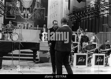 Duke Ellington and Orchestra February 1966 recorded a concert for ABC Television in Conventry Cathedral Duke discuss - Stock Photo