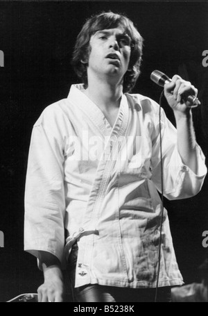 Peter Gabriel the rock star former lead singer with Genesis during a solo concert in Paris where he sang to an audience - Stock Photo