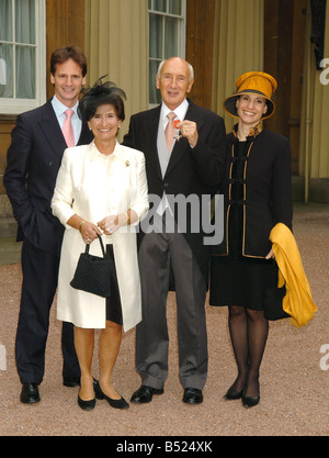 TV Sports comentator Barry Davies with his MBE Medal at the Investiture at Buckingham Palace With wife Penny and - Stock Photo