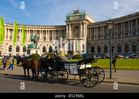 Horse carriage driver talking on a mobile phone at Heldenplatz square in central Vienna Austria Europe - Stock Photo