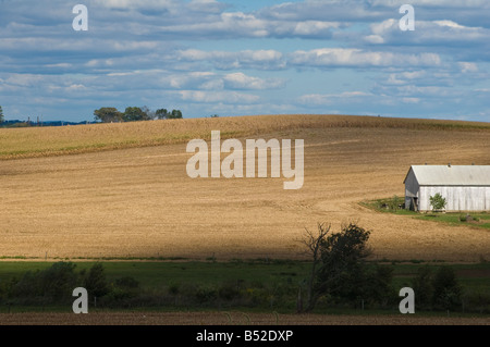 afternoon shadows on rolling hillside - Stock Photo