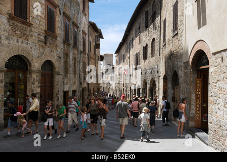 Typical street in the old town, San Gimignano, Tuscany, Italy - Stock Photo