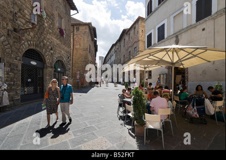 Cafe on Via San Matteo (one of the main in the old town), San Gimignano, Tuscany, Italy - Stock Photo