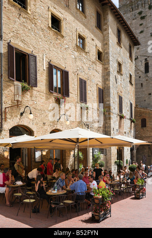 Cafe in Piazza della Cisterna in the centre of the old town, San Gimignano, Tuscany, Italy - Stock Photo