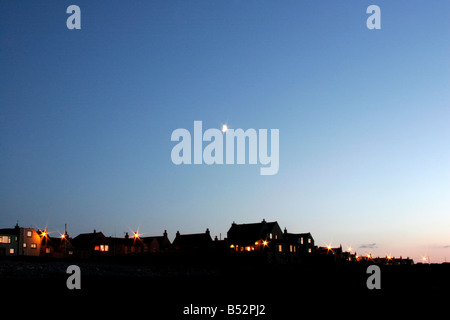 Moon above Inverallochy and Cairnbulg on the North East coast of Scotland - Stock Photo