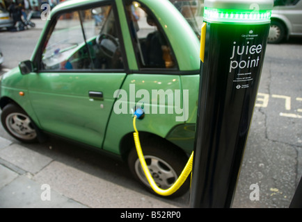 A G Wiz electric car charging from a City of Westminster Juice point in central London - Stock Photo