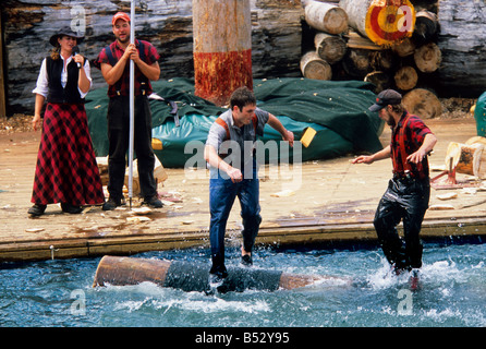 Lumberjacks compete in the log rolling competition during the Great Alaskan Lumberjack Show in Ketchikan in Southeast, - Stock Photo