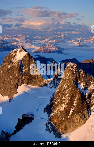 Aerial view of Juneau Ice Field bathed in evening light, looking past the Taku Range to Devil's Paw Southeast Alaska - Stock Photo