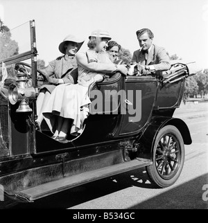 Filming of Genevieve  L - R Kay Kendall - Dinah Sheridan, John Gregson and Kenneth Moore. September 1952 - Stock Photo