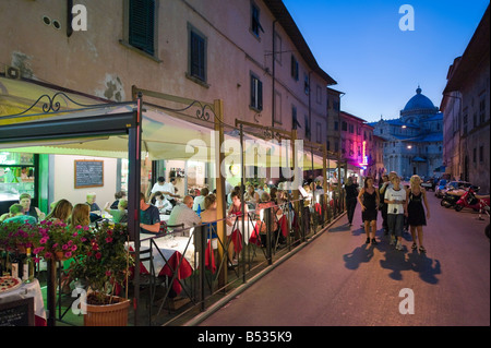Restaurant at night on Via Santa Maria leading to the Duomo and Piazza dei Miracoli, Pisa, Tuscany, Italy - Stock Photo