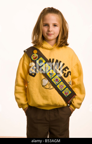 10 year old girl dressed in her Brownies uniform - Stock Photo