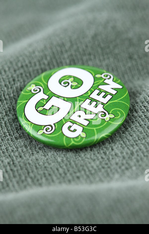 Go Green pin on shirt close up - Stock Photo