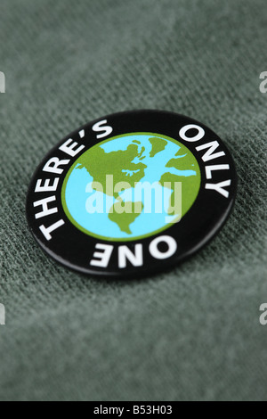 Close up of planet earth pin on shirt