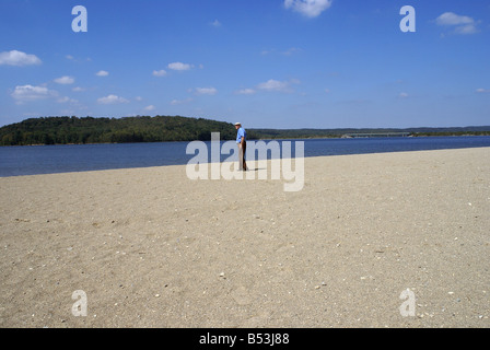 Small figure on Beach - Stock Photo