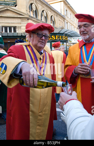A local wine grower pouring wine at the opening cermony of the fete des Vendanges, Neuchatel, Switzerland - Stock Photo
