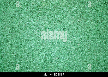 A green artificial astro turf texture commonly used in ball sports - Stock Photo