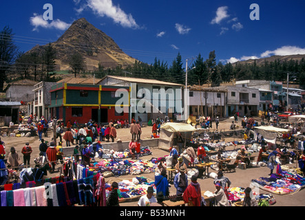 Ecuadorian people person new and used clothes clothing vendors at market day Zumbahua Cotopaxi Province Ecuador - Stock Photo