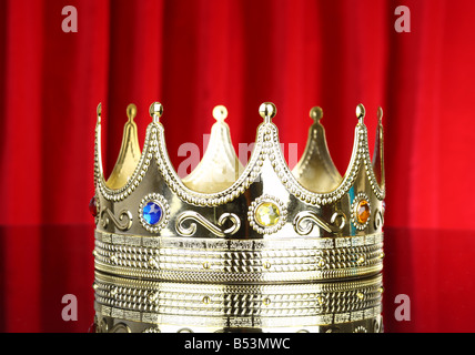 Crown with red curtain background - Stock Photo