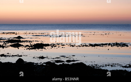 Sunset over the sea at Inverallochy and Cairnbulg on the North East coast of Scotland - Stock Photo