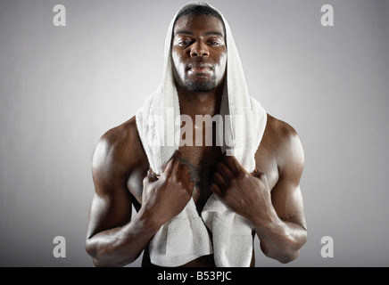 Sweating African man with towel - Stock Photo