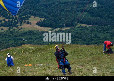 Paragliders on Le Puy de Dome, France - Stock Photo
