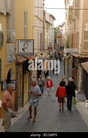 Narrow street in the old part of Antibes in Southern France - Stock Photo