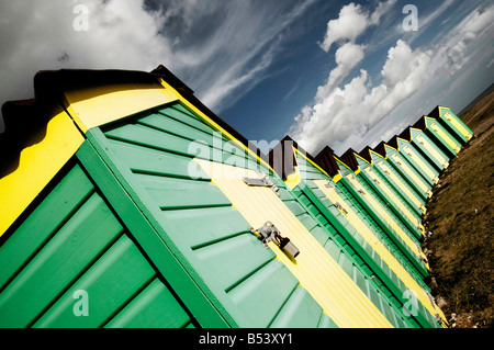 Colourful Beach huts on Littlehampton beach west sussex - Stock Photo