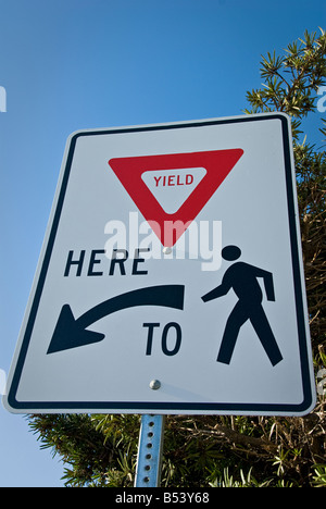Yield here to pedestrian traffic sign - Stock Photo
