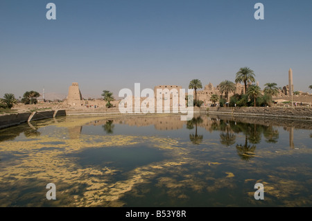 General view of the Sacred Lake and Karnak Temple complex, Luxor Egypt - Stock Photo