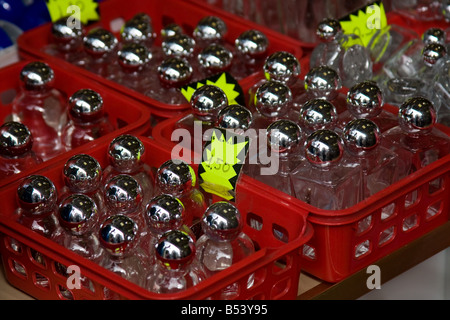 Holy water bottles - Lourdes, Southern France - Stock Photo